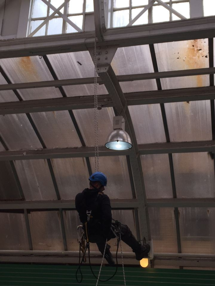 rope access technician climbs up to the atrium above Jungle Jim's Play area