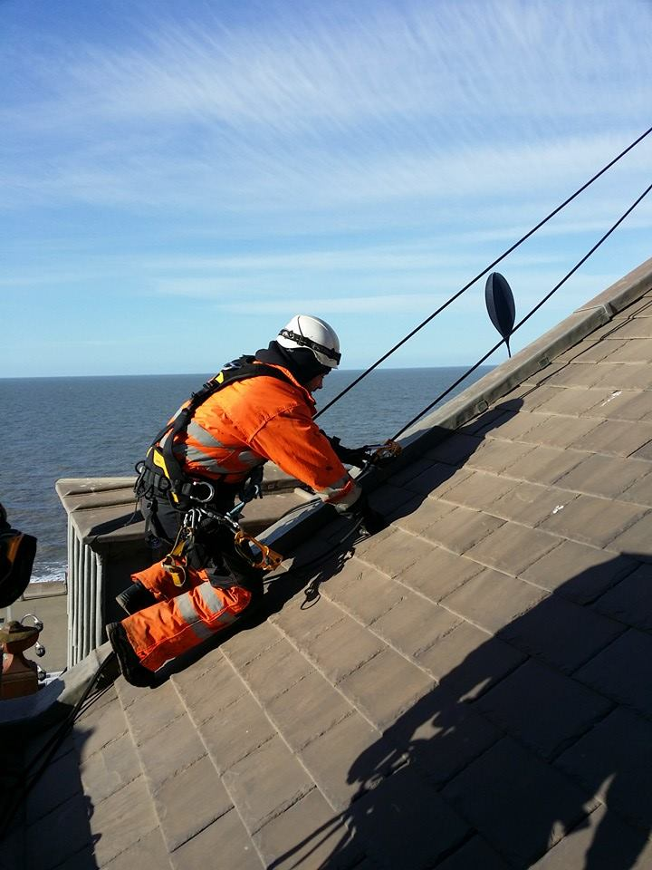 rope access technicians checks the integrity of the roof at Blackpool Tower