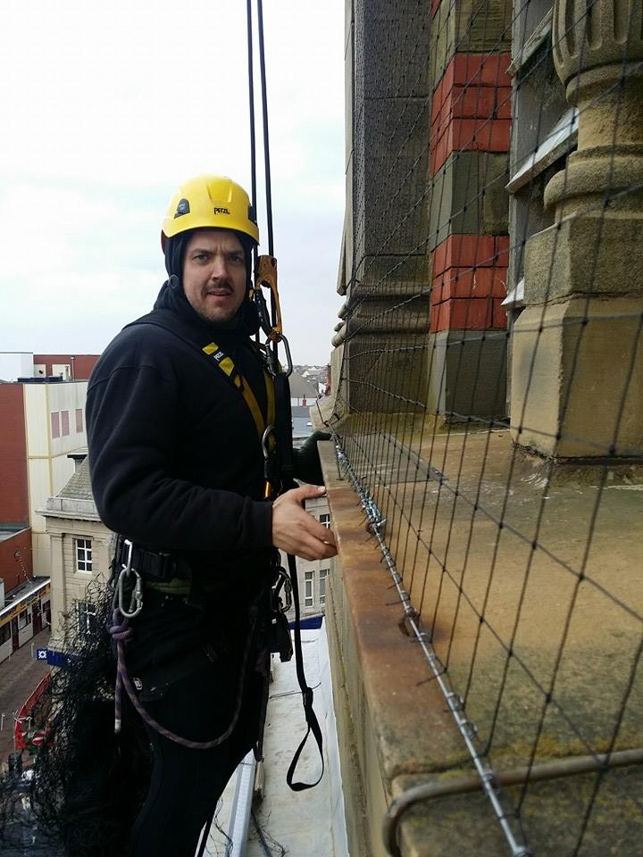 rope access technicians installs bird netting on Blackpool Town Hall
