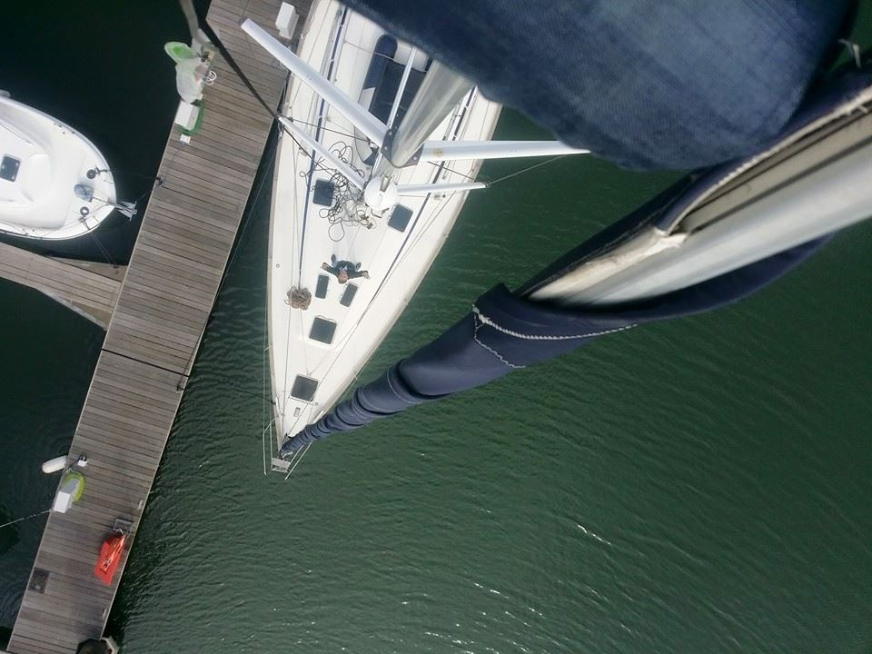 Rope access technician climbs up the mast of the 'Atlas' Sailing yacht.