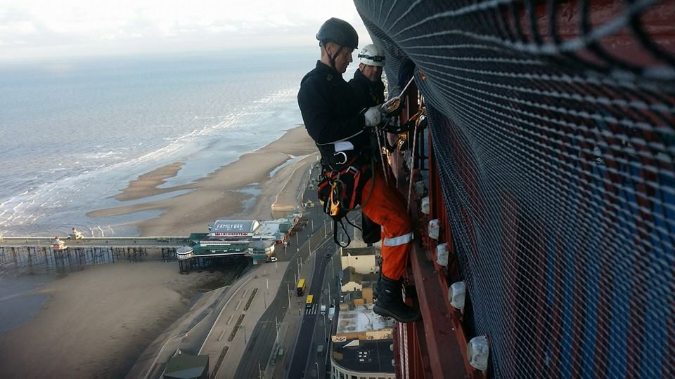 Rope Access technicians carry out safety neeting inspections at the top of Blackpool Tower - Blackpool Tower Safety Netting and Glazing Installation