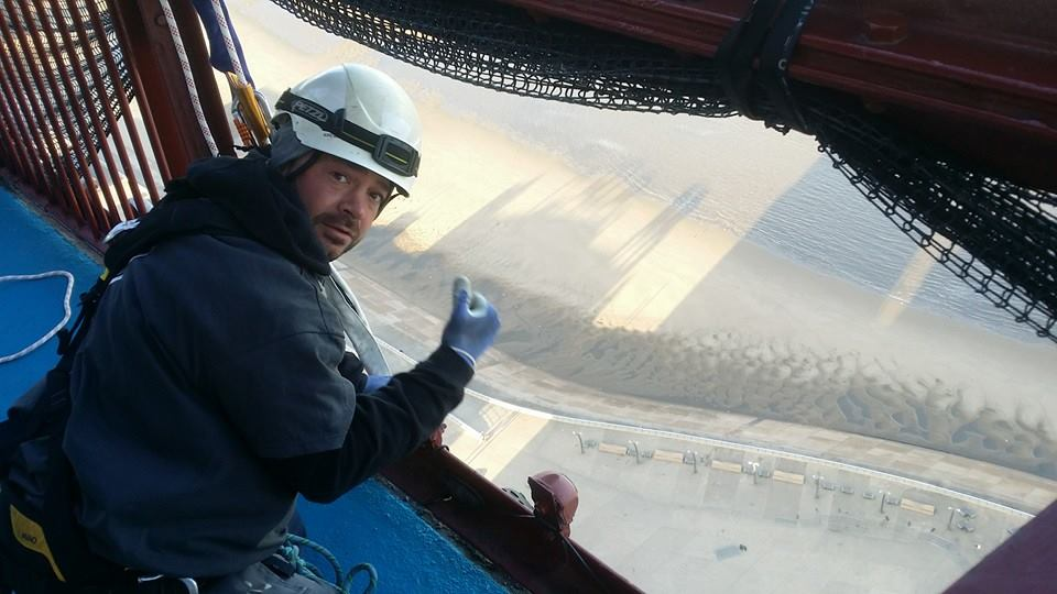 rope access team get ready to abseil down to replace glazing on Blackpool Tower.