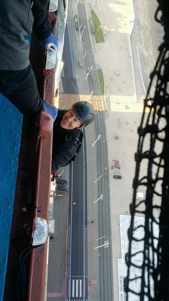 rope access technician installs safety netting at the top of Blackpool Tower