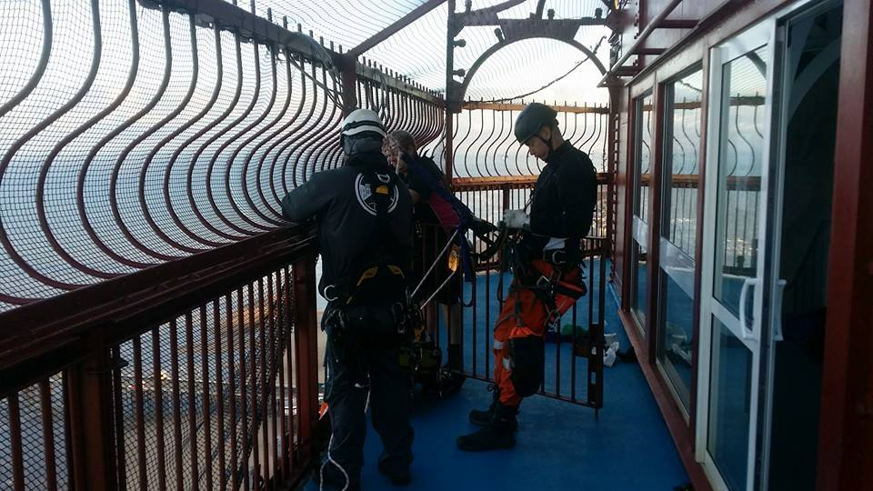 Rope access technicians get ready to abseil down to complete some much neede maintenance on Blackpool Tower based in the North West of England near Manchester