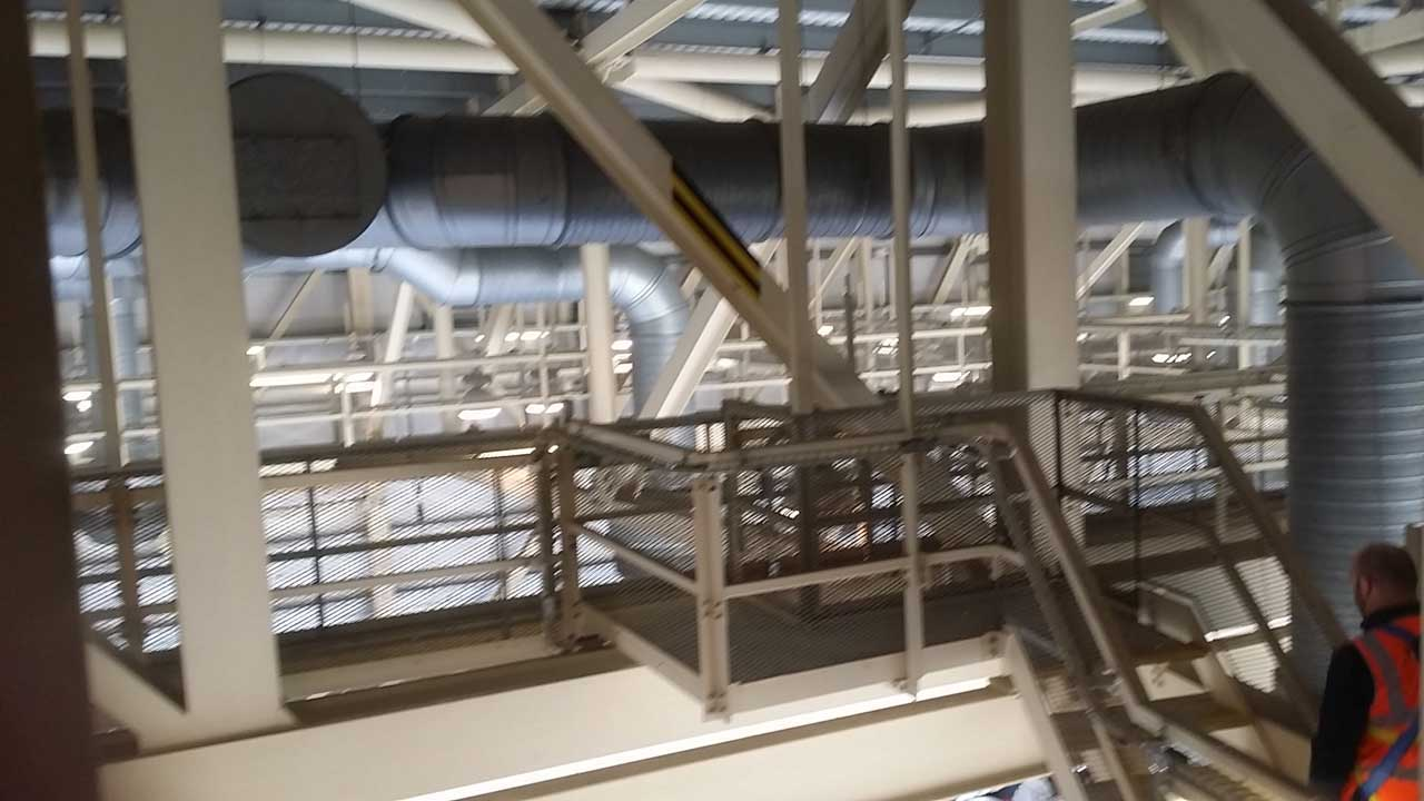 rope access technicians install bird netting and bird spikes in the roof space of Virgin Hangar at Londons Heathrow