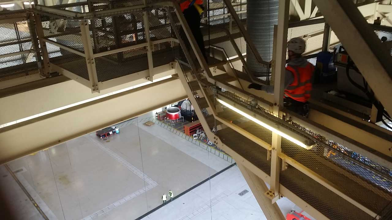 rope access technicians survey the high level area before commencing bird netting installation